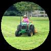 Blue Dog Farm Tractor Mowing
